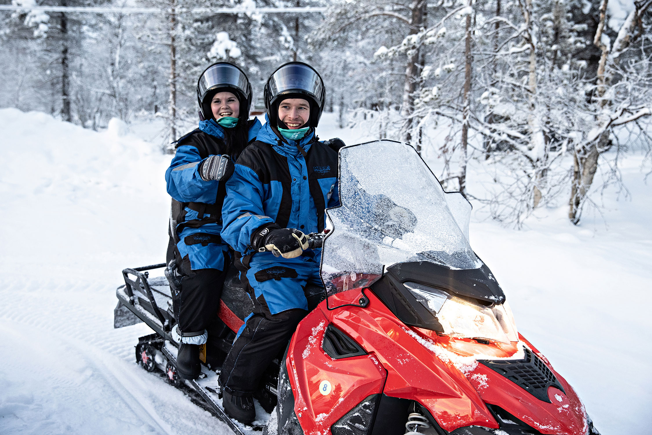 Speed up on a snowmobile to explore the wilderness.
